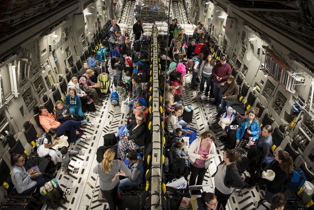 Dependents of military members from Incirlik Air Base, Turkey, wait to disembark from a C-17 Globemaster III after landing at Baltimore Washington International Airport, Md., April 1, 2016. Defense Department dependents in Adana, Izmir and Mugla, Turkey, were given an ordered departure by the State Department and Secretary of Defense. (U.S. Air Force photo/Staff Sgt. Andrew Lee)