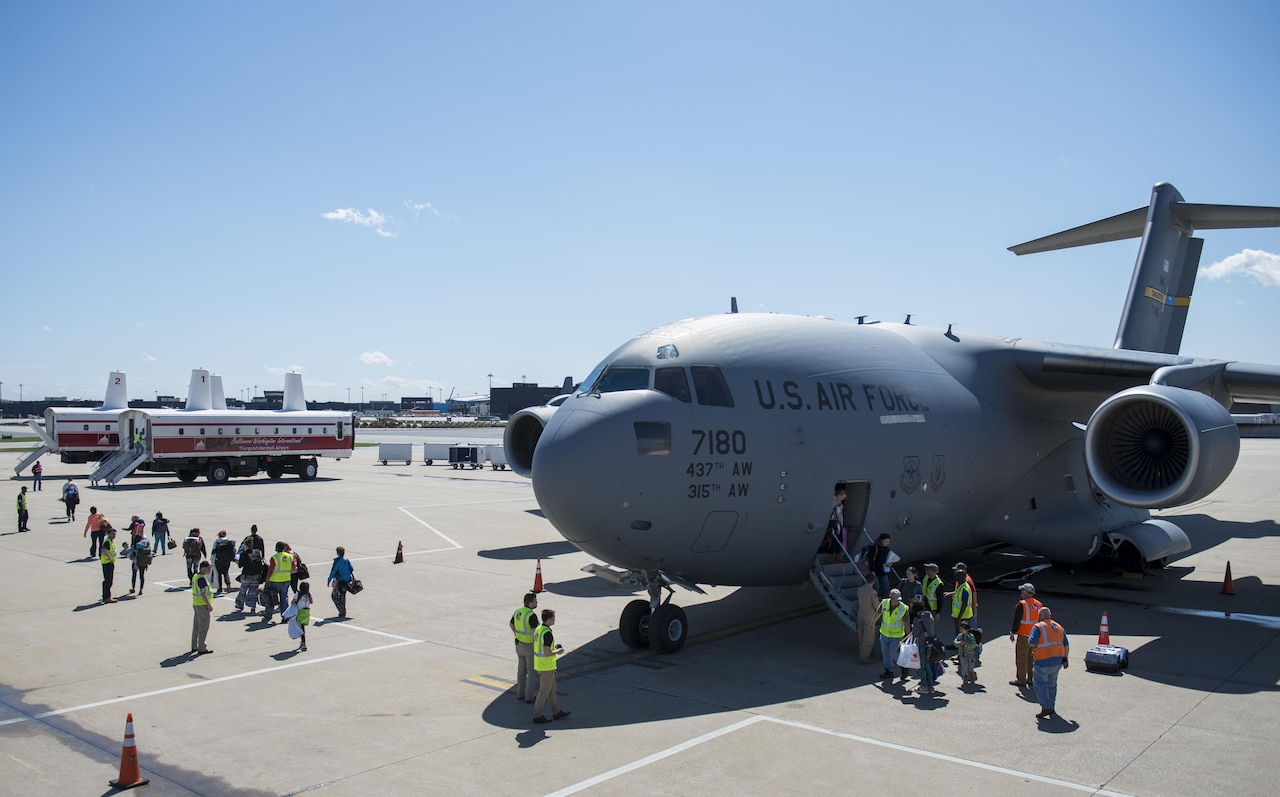 Dependents of military members from Incirlik Air Base, Turkey, disembark from a C-17 Globemaster III after landing at Baltimore Washington International Airport, Md., April 1, 2016. Defense Department dependents in Adana, Izmir and Mugla, Turkey, were given an ordered departure by the State Department and Secretary of Defense. The aircraft is assigned to the 437th Airlift Wing at Joint Base Charleston, S.C. (U.S. Air Force photo/Staff Sgt. Andrew Lee)