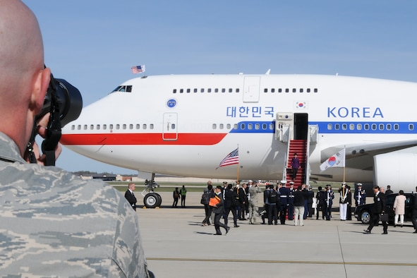 Technical Sgt. Malachi Woodlee, 459th Maintenance Squadron repair/reclamation craftsman and Nuclear Security Summit volunteer, takes pictures of the arrival of Park Geun-hye, President of South Korea, on the Joint Base Andrews, Md., flight line March 30. More than 20 international heads of state arrived here for the 2016 NSS held in Washington, D.C. The summit provides a forum for leaders to reinforce commitments to securing nuclear materials. (U.S. Air Force photo/Staff Sgt. Kat Justen)
