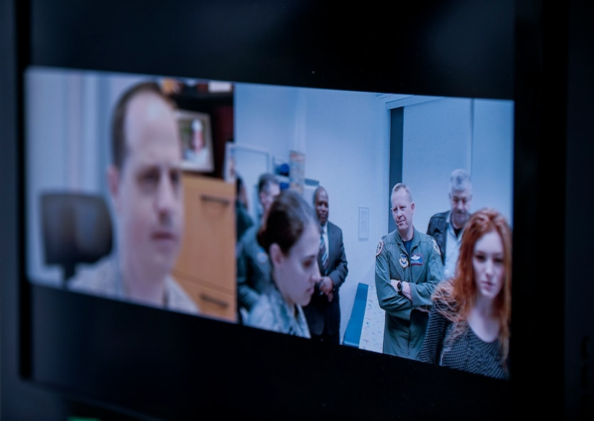 Members of the 52nd Fighter Wing leadership use the Telehealth cart to video conference with Landstuhl Regional Medical Center after the 52nd Medical Group/LRMC Telehealth ribbon cutting inside the 52nd MDG clinic April 1, 2016, at Spangdahlem Air Base, Germany. The Telehealth cart uses VTC and other medical instruments to provide doctors from LRMC with real-time readings on patient vital signs. (U.S. Air Force photo by Senior Airman Rusty Frank/Released)