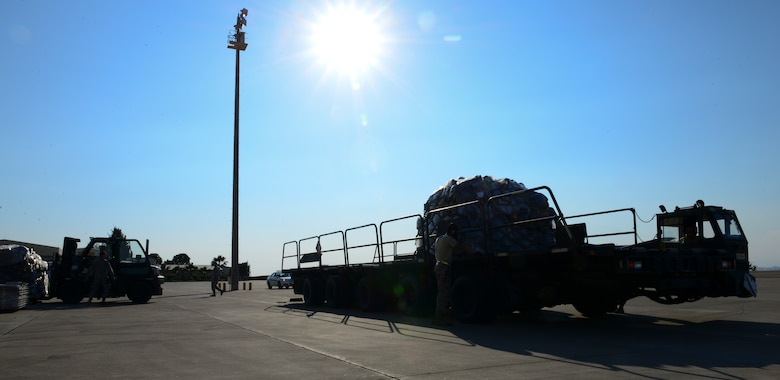 Members of the 728th Air Mobility Squadron load a Halverson lift with luggage, March 31, 2016, at Incirlik Air Base, Turkey. The 728th AMS built, staged and transported the pallets to load in an aircraft to aid in the process of an ordered departure. (U.S. Air Force photo by Staff Sgt. Caleb Pierce/Released)