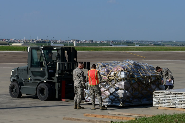 Members of the 728th Air Mobility Squadron along with volunteers, stage a pallet of luggage during an ordered departure for dependents, March 31, 2016, at Incirlik Air Base, Turkey. The Secretary of Defense, in coordination with the Secretary of State, ordered the departure of all Department of Defense dependents assigned to Incirlik Air Base. (U.S. Air Force photo by Staff Sgt. Caleb Pierce/Released)