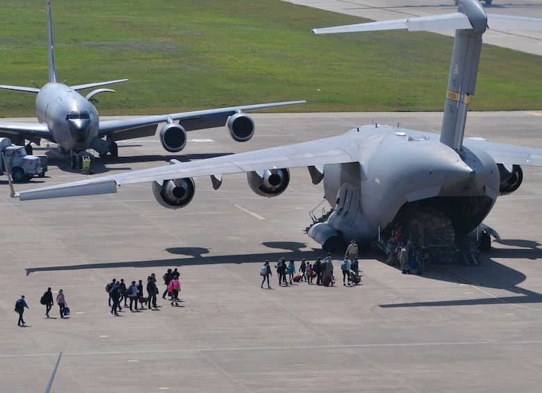 Families of U.S. Airmen and Department of Defense civilians board a C-17 Globemaster III during an ordered departure, March 30, 2016, at Incirlik Air Base, Turkey. On March 29, 2016, the Secretary of Defense, in coordination with the Secretary of State, ordered the departure of all DOD dependents assigned to Incirlik Air Base. (U.S. Air Force photo by Senior Airman John Nieves Camacho/Released)