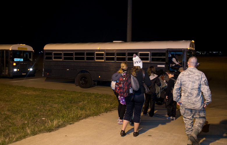 Families of U.S. Airmen and Department of Defense civilians board a bus to be taken to the passenger terminal during an ordered departure March 30, 2016 at Incirlik Air Base, Turkey. U.S. forces stationed at Incirlik Air Base aided in the transportation of citizens returning to the United States. (U.S. Air Force photo by Staff Sgt. Eboni Reams/Released)