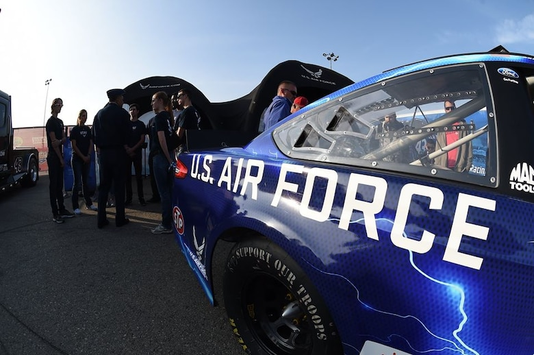 Lt. Gen. Samuel Greaves, SMC commander and Air Force program executive office for space, visits with Air Force Delayed Entry recruits in the pit area during a racing event at the Auto Club Speedway, March 20. (US Air Force photo/Joe Juarez)