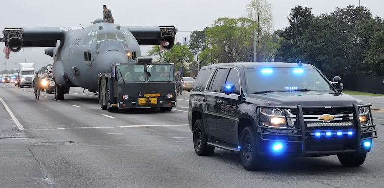 Houston County Sheriff's Office personnel escort the C-130 trainer as it heads to its final destination, March 25, 2016. (U. S. Air Force photo by Roland Leach)