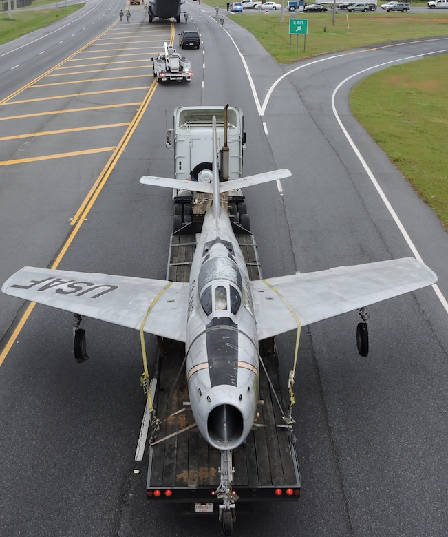 An Air National Guard F-84F Thunderstreak is towed down Ga. Highway 247 to the Museum of Aviation, March 25, 2016. (U. S. Air Force photo by Roland Leach)