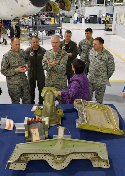 Gen. Paul J. Selva, Vice Chairman of the Joint Chiefs of Staff, center foreground, receives a briefing by Ms. Theresa Farris, 564th Aircraft Maintenance Squadron director, on how the Oklahoma City Air Logistics Complex supports the nuclear mission to include the KC-135, B-52, B-2, commodities, software and engines. The briefing was held Friday in Bldg. 3001, Dock 9 ½, at Tinker Air Force Base. (U.S. Air Force photo by Greg L. Davis)