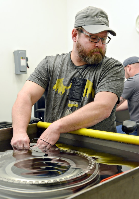 Owen Baker, an ultrasonic inspector with the 548th Propulsion Maintenance Squadron, performs an inspection on the scallops on a part of an F109 engine to check for minute cracks in the part that could compromise the integrity of the part. Mr. Baker is training to receive his Level 1 inspector certification, which is 400 hours of training. A Level 2 inspector will receive 1,200 more hours of training to become certified. (Air Force photo by Kelly White/Released)