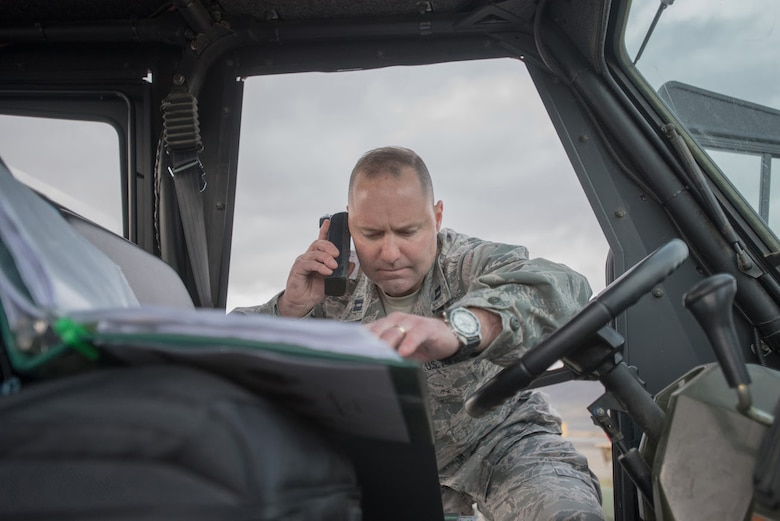 U.S. Air Force Capt. James Embry, air operations officer with the Kentucky Air National Guard's 123rd Contingency Response Group, communicates joint mission-essential tasks to higher headquarters at Amedee Army Airfield, Calif., on March 6, 2016. The 123rd CRG is working in conjunction with the U.S. Army's 688th Rapid Port Opening Element and a team from the Defense Logistics Agency to operate Joint Task Force-Port Opening Sangala during a week-long exercise called Operation Lumberjack. The objective of the JTF-PO is to establish an aerial port of debarkation, provide initial distribution capability and set up warehousing for distribution beyond a forward node. (Kentucky Air National Guard photo by Master Sgt. Phil Speck)