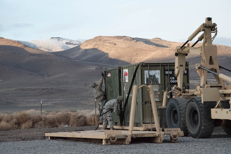 Soldiers from the U.S. Army's 688th Rapid Port Opening Element secure equipment for transport to the forward node at Amedee Army Airfield, Calif., March 7, 2016. The 688th RPOE is working in conjunction with the Kentucky Air National Guard's 123rd Contingency Response Group and a team from the Defense Logistics Agency to operate Joint Task Force-Port Opening Sangala during a week-long exercise called Operation Lumberjack. The objective of the JTF-PO is to establish an aerial port of debarkation, provide initial distribution capability and set up warehousing for distribution beyond a forward node. (Kentucky Air National Guard photo by 1st Lt. James Killen)