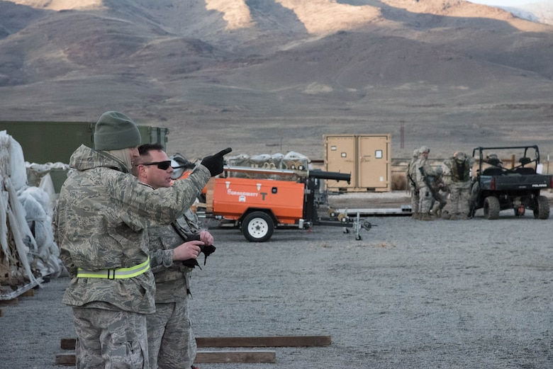 Airmen from the Kentucky Air National Guard's 123rd Contingency Response Group discuss the movement of equipment delivered by airlift to Amedee Army Airfield, Calif., March 7, 2016. 123rd CRG is working in conjunction with the U.S. Army's 688th Rapid Port Opening Element and a team from the Defense Logistics Agency to operate Joint Task Force-Port Opening Sangala during a week-long exercise called Operation Lumberjack. The objective of the JTF-PO is to establish an aerial port of debarkation, provide initial distribution capability and set up warehousing for distribution beyond a forward node. (Kentucky Air National Guard photo by 1st Lt. James Killen)