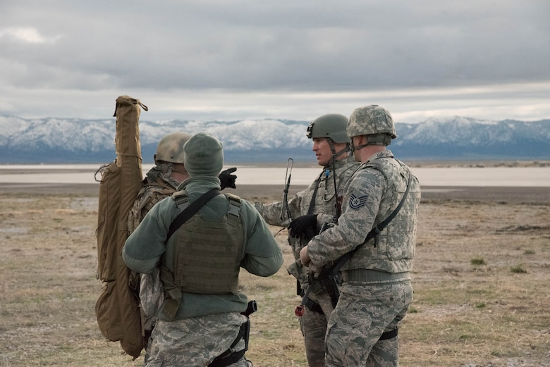 Airmen from the Kentucky Air National Guard's 123rd Contingency Response Group discuss the security posture at Amedee Army Airfield, Calif., March 7, 2016. The 123rd CRG is working in conjunction with the U.S. Army's 688th Rapid Port Opening Element and a team from the Defense Logistics Agency to operate Joint Task Force-Port Opening Sangala during a week-long exercise called Operation Lumberjack. The objective of the JTF-PO is to establish an aerial port of debarkation, provide initial distribution capability and set up warehousing for distribution beyond a forward node. (Kentucky Air National Guard photo by 1st Lt. James Killen)