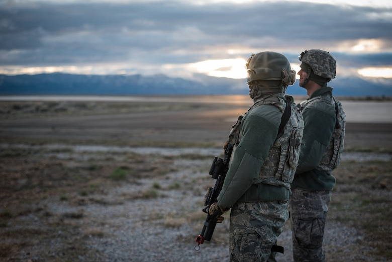 Airmen from the Kentucky Air National Guard's 123rd Contingency Response Group keep watch over the flight line at Amedee Army Airfield, Calif., on March 7, 2016. The 123rd CRG is working in conjunction with the U.S. Army's 688th Rapid Port Opening Element and a team from the Defense Logistics Agency to operate Joint Task Force-Port Opening Sangala during a week-long exercise called Operation Lumberjack. The objective of the JTF-PO is to establish an aerial port of debarkation, provide initial distribution capability and set up warehousing for distribution beyond a forward node. (Kentucky Air National Guard photo by Master Sgt. Phil Speck)
