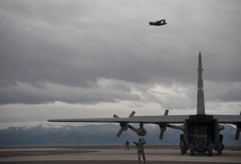 A C-130 Hercules aircraft from the Wyoming Air National Guard delivers cargo to Amedee Army Airfield, Calif., in support of Operation Lumberjack on March 8, 2016. The Kentucky Air National Guard's 123rd Contingency Response Group is working in conjunction with the U.S. Army's 688th Rapid Port Opening Element and a team from the Defense Logistics Agency to operate Joint Task Force-Port Opening Sangala during the week-long exercise. The objective of the JTF-PO is to establish an aerial port of debarkation, provide initial distribution capability and set up warehousing for distribution beyond a forward node. (Kentucky Air National Guard photo by 1st Lt. James Killen)