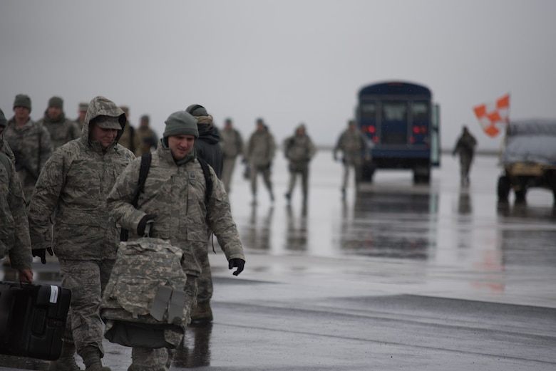 Airmen from the Kentucky Air National Guard's 123rd Contingency Response Group arrive at Amedee Army Airfield, Calif., during Operation Lumberjack on March 7, 2016. The Kentucky Air National Guard's 123rd CRG, the U.S. Army's 688th Rapid Port Opening Element and a team from the Defense Logistics Agency are all participating in the week-long exercise. (Kentucky Air National Guard photo by Master Sgt. Phil Speck)