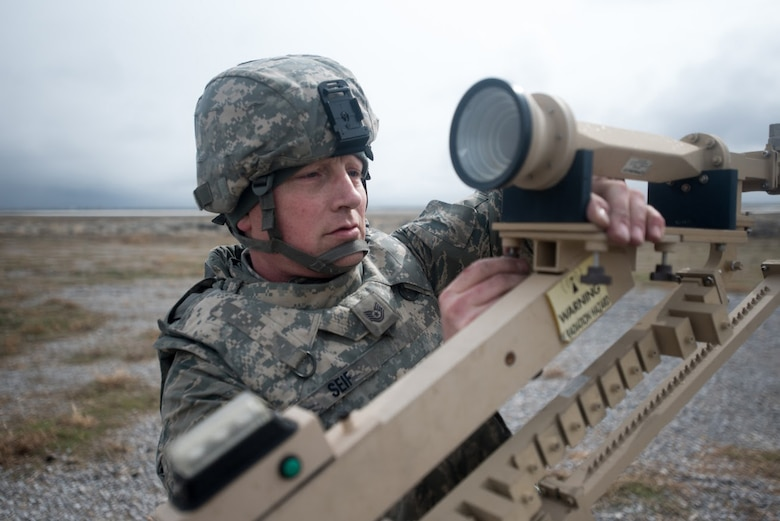 U.S. Air Force Tech. Sgt. Phil Seif, a communications specialist with the Kentucky Air National Guard's 123rd Contingency Response Group, sets up a communication satellite at Amedee Army Airfield, Calif., on March 7, 2016. The 123rd CRG is working in conjunction with the U.S. Army's 688th Rapid Port Opening Element and a team from the Defense Logistics Agency to operate Joint Task Force-Port Opening Sangala during a week-long exercise called Operation Lumberjack. The objective of the JTF-PO is to establish an aerial port of debarkation, provide initial distribution capability and set up warehousing for distribution beyond a forward node. (Kentucky Air National Guard photo by Master Sgt. Phil Speck)