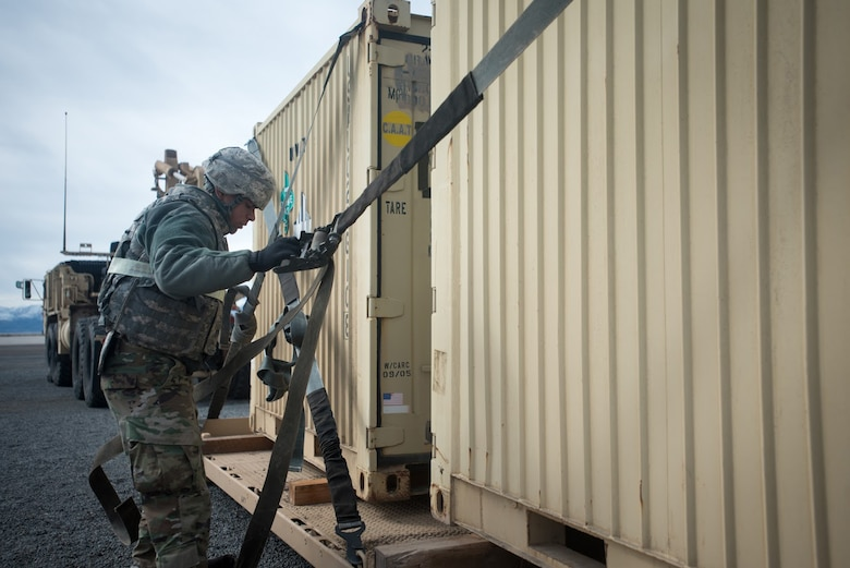U.S. Army Pfc. Kenneth Gaud, a cargo specialist for the 688th Rapid Port Opening Element, straps cargo to a pallet at Amedee Army Airfield, Calif., during Operation Lumberjack on March 8, 2016. The 688th RPOE, the Kentucky Air National Guard's 123rd Contingency Response Group and a team from the Defense Logistics Agency are all participating in the week-long exercise. (Kentucky Air National Guard photo by Master Sgt. Phil Speck)