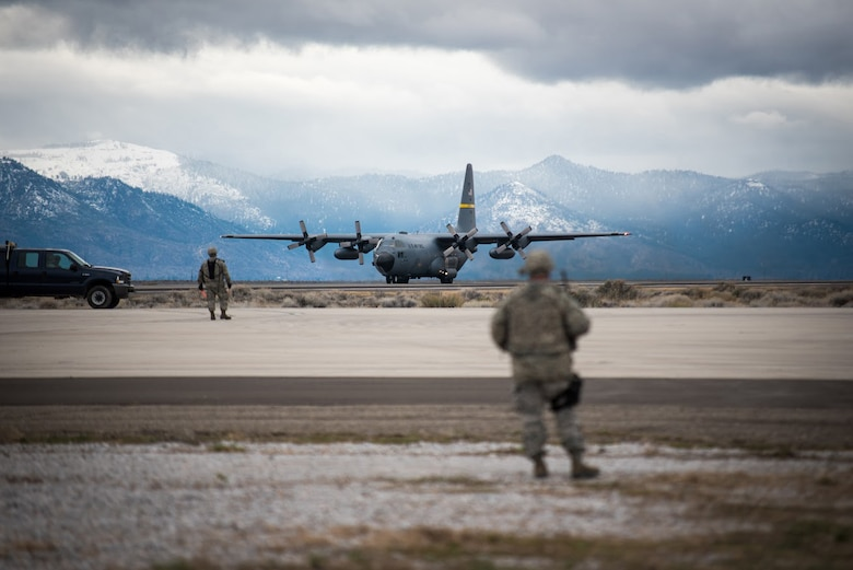 Members of theKentucky Air National Guard's 123rd Contingency Response Group prepare to unload a Wyoming Air National Guard C-130 Hercules at Amedee Army Airfield, Calif., on March 8, 2016. The 123rd CRGis working inconjunction with the U.S. Army's 688th Rapid Port Opening Element and a team from the Defense Logistics Agency to operateJoint Task Force-Port Opening Sangala duringa week-long exercise called Operation Lumberjack. The objective of the JTF-PO is to establish an aerial port of debarkation, provide initial distribution capability and set up warehousing for distribution beyond a forward node. (Kentucky Air National Guard photo by Master Sgt. Phil Speck)