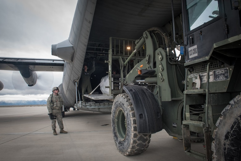 Aerial porters from the Kentucky Air National Guard's 123rd Contingency Response Group unload cargo from a Wyoming Air National Guard C-130 at Amedee Army Airfield, Calif., on March 8, 2016. The 123rd CRG is working in conjunction with the U.S. Army's 688th Rapid Port Opening Element and a team from the Defense Logistics Agency to operate Joint Task Force-Port Opening Sangala during a week-long exercise called Operation Lumberjack. The objective of the JTF-PO is to establish an aerial port of debarkation, provide initial distribution capability and set up warehousing for distribution beyond a forward node. (Kentucky Air National Guard photo by Master Sgt. Phil Speck)