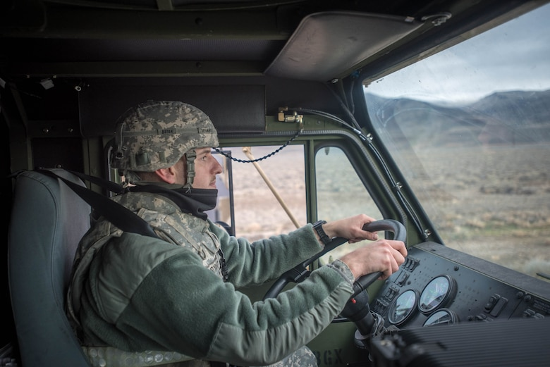 U.S. Army Spc. Anthony Bryant, a motor transport operator for the 688th Rapid Port Opening Element, drives a Load Handling System vehicle to transport cargo to the forward operating node at Amedee Army Airfield, Calif., on March 9, 2016. The 688th RPOE is working in conjunction with the Kentucky Air National Guard's 123rd Contingency Response Group and a team from the Defense Logistics Agency to operate Joint Task Force-Port Opening Sangala during a week-long exercise called Operation Lumberjack. The objective of the JTF-PO is to establish an aerial port of debarkation, provide initial distribution capability and set up warehousing for distribution beyond the forward node. (Kentucky Air National Guard photo by Master Sgt. Phil Speck)