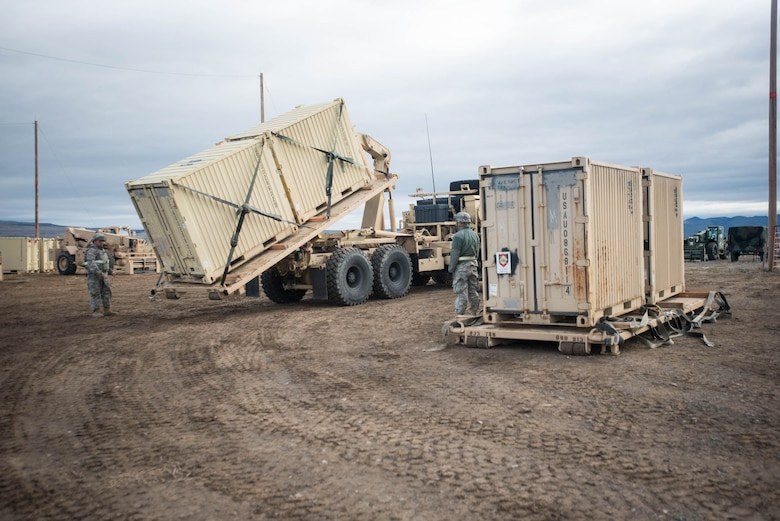 Soldiers from the U.S. Army's 688th Rapid Port Opening Element use a Load Handling System to unload cargo at the forward operating node at Amedee Army Airfield, Calif., on March 9, 2016. The 688th RPOE is working in conjunction with the Kentucky Air National Guard's 123rd Contingency Response Group and a team from the Defense Logistics Agency to operate Joint Task Force-Port Opening Sangala during a week-long exercise called Operation Lumberjack. The objective of the JTF-PO is to establish an aerial port of debarkation, provide initial distribution capability and set up warehousing for distribution beyond the forward node. (Kentucky Air National Guard photo by Master Sgt. Phil Speck)