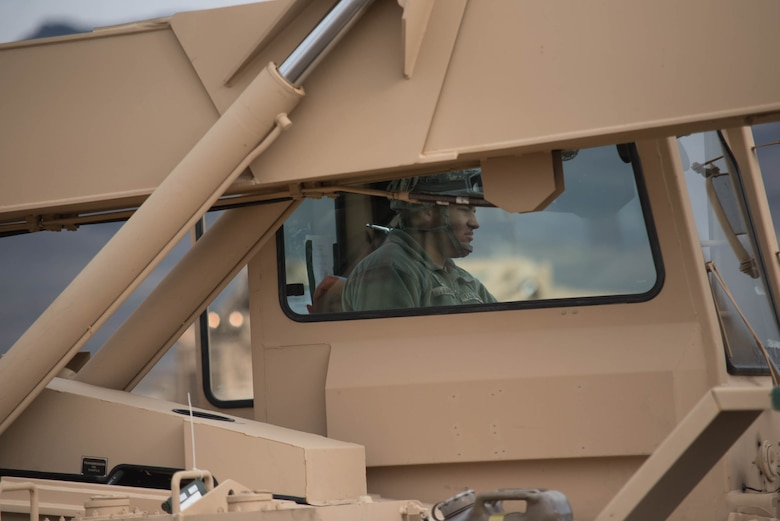 U.S. Army Pfc. Matthew Avery, an all-terrain forklift operator for the 688th Rapid Port Opening Element, moves cargo at the forward operating node at Amedee Army Airfield, Calif., on March 9, 2016. The 688th RPOE is working in conjunction with the Kentucky Air National Guard's 123rd Contingency Response Group and a team from the Defense Logistics Agency to operate Joint Task Force-Port Opening Sangala during a week-long exercise called Operation Lumberjack. The objective of the JTF-PO is to establish an aerial port of debarkation, provide initial distribution capability and set up warehousing for distribution beyond the forward node. (Kentucky Air National Guard photo by Master Sgt. Phil Speck)
