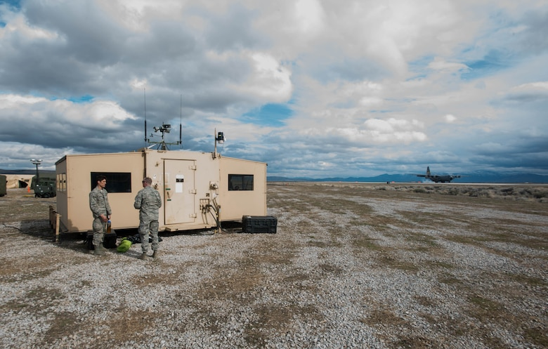 A Wyoming Air National Guard C-130 Hercules lands next to the 123rd Contingency Response Group's Hardened Expeditionary Light Air Mobile Shelter at Amedee Army Airfield, Calif., during Operation Lumberjack on March 9, 2016. The 123rd CRG, a unit of the Kentucky Air National Guard, is working in conjunction with the U.S. Army's 688th Rapid Port Opening Element and a team from the Defense Logistics Agency to operate Joint Task Force-Port Opening Sangala during the week-long exercise. The objective of the JTF-PO is to establish an aerial port of debarkation, provide initial distribution capability and set up warehousing capability for distribution beyond a forward node. (Kentucky Air National Guard photo by Master Sgt. Phil Speck)