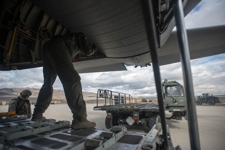 Aerial porters from the Kentucky Air National Guard's 123rd Contingency Response Group use a Halvorsen Loader to off-load cargo from a New York Air National Guard C-130 at Amedee Army Airfield, Calif., during Operation Lumberjack on March 9, 2016. The 123rd CRG is working in conjunction with the U.S. Army's 688th Rapid Port Opening Element and a team from the Defense Logistics Agency to operate Joint Task Force-Port Opening Sangala during the week-long exercise. The objective of the JTF-PO is to establish an aerial port of debarkation, provide initial distribution capability and set up warehousing for distribution beyond a forward node. (Kentucky Air National Guard photo by Master Sgt. Phil Speck)