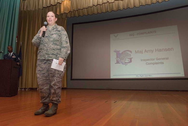 Maj. Amy Hansen, 940th Wing Inspector General, gave an overview of her services at the 940th Wing commander's all call March 5, 2016 at Beale Air Force Base, California. As inspector general she oversees the prevention of government fraud, waste and abuse, serves as the eyes and ears for the wing commander, and acts as a resource for those unable to resolve concerns through their chain of command. (U.S. Air Force Photo/ Tech. Sgt. Kenneth McCann)