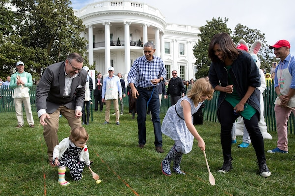 President Barack Obama and First Lady Michelle Obama cheer children on during the annual White House Easter Egg Hunt, March 28, 2016. Military children and families were among the 35,000 invited participants. White House photo by Pete Souza