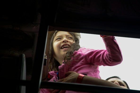 A young girl looks out the top of a C-17 Globemaster III from Wright-Patterson AFB, Ohio during the at the 2016 FIDAE Air and Space Trade Show in Santiago, Chile, April 1, 2016. Airmen from around the U.S. came to Chile to participate in the FIDAE Air Show 2016, from March 29– April 3, 2016.  During their stay, they made time to connect one-on-one with members of the community and hosted children from the Make-A-Wish and Teletón Foundations. (U.S. Air Force photo by Tech. Sgt. Heather Redman/Released)
