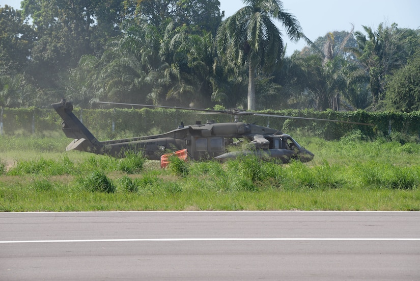 A U.S. Army UH-60 Black Hawk with the 1-228th Aviation Regiment prepares to take off with a Bambi Bucket March 31, 2016, Tela, Honduras, to respond to a request from Honduran President Juan Orlando Hernandez for support in extinguishing a forest fire near Tela. The Honduran Fire Department, Air Force and Army worked with U.S. air assets from Joint Task Force-Bravo at Soto Cano Air Base, Honduras, to control and extinguish the fire. (U.S. Air Force photo by Staff Sgt. Westin Warburton/ Released)