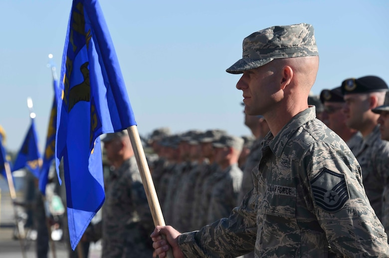 Airmen assigned to the 144th Fighter Wing stand in formation during a change of command ceremony at the Fresno Air National Guard Base April 2, 2016. U.S. Air Force Col. Reed Drake assumed command of the 144th FW from U.S. Air Force Brig. Gen. Clay Garrison, who will continue his service as the Assistant Adjutant General-Air California National Guard. (U.S. Air National Guard photo by Senior Airman Klynne Pearl Serrano)