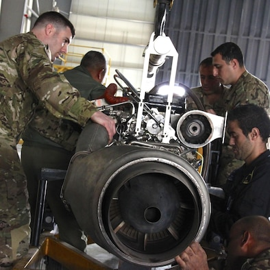 Combat Aviation Advisors help partner nation mechanics with aircraft engine maintenance during a deployed mission in March.  A CAA deployment sends a small team of Airmen to assess, advise, train, and assist friendly and allied forces with their own airpower resources.  Duke Field is the home of the only two CAA squadrons in the Air Force, the active-duty 6th Special Operations Squadron and the Reserve 711th SOS.  (Courtesy photo)