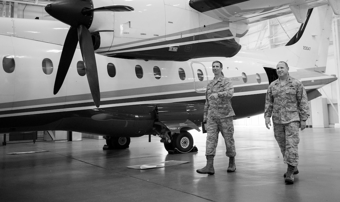 Col. Bryan Ratliff (left), 10th Air Force vice commander,  tours a C-146 Wolfhound with Col. Kurt Matthews (right), 919 Special Operations group, during an immersion tour of Duke Field on March 31.  The purpose of the tour was to learn the integration of the wing's mission, operations and personnel. (U.S. Air Force photo/Tech. Sgt. Jasmin Taylor)