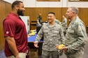 Kedric Golston, a professional football player with the Washington Redskins, laughs with Chaplain (Brig. Gen.) Steven Schaick, U.S. Air Force deputy chief of chaplains, and Chaplain (Maj.) Joshua Kim, chaplain for the 459th Air Refueling Wing, before the 459th ARW's Annual Prayer Breakfast on April 3, 2016 on Joint Base Andrews, Md. More than 150 reservists from the 459th attended the second annual breakfast. (U.S. Air Force photo/Staff Sgt. Scott Pauley)