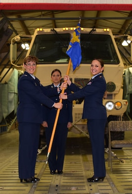 (Left) Col. Lisa M. Craig, 433rd Mission Support Group commander, passes the 433rd Logistics Readiness Squadron guidon to new squadron commander, Maj. Coleen A. Barnett, during a change of command ceremony April 2, 2016 at the Cargo Load Facility on Joint Base San Antonio-Lackland. Prior to taking command of the 433rd LRS, Barnett was an operations officer within the unit. (U.S. Air Force photo by Tech. Sgt. Lindsey Maurice)