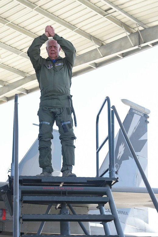 U.S. Air Force Brig. Gen. (ret.) Robert Earthquake Titus steps off of a 144th Fighter Wing F-15D Eagle at the Fresno Air National Guard Base, April 1, 2016. Titus is the 144th Fighter Wing's 3rd Annual Heritage Week honored guest, who had the opportunity to sit in the cockpit of an F-15 and also shared his personal experiences as a fighter pilot with the 144th FW Airmen. (U.S. Air National Guard photo by Senior Airman Klynne Pearl Serrano)