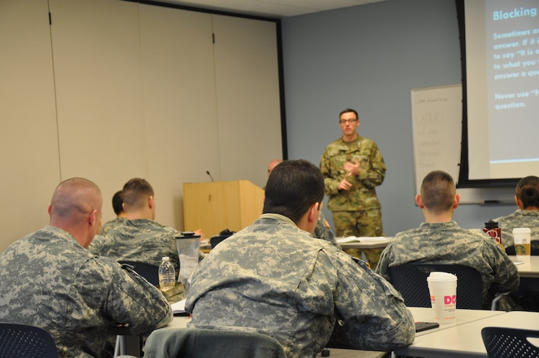 Capt. Mike Petersen, Connecticut National Guard State Public Affairs Officer, teaches unit public affairs representative trainees how to interact with the civilian media during the 2016 UPAR training course at the Regional Training Institute, Camp Niantic, Jan 30-31. UPARs were also instructed on basic writing skills, unit social media conduct, developing  story ideas and taking photos. (Photo by Allison L. Joanis, State Public Affairs Office)
