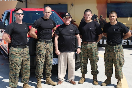 Marines from Recruiting Substation Perrine, Recruiting Station Fort Lauderdale pose with General Robert Magnus (USMC Ret) the 30th Assistant Commandant of the Marine Corps at the Southernmost Air Spectacular featuring the Navy and Marine Corps Blue Angels at Naval Air Station Key West Florida. (Photo by Sgt Michael Lopez, USMC)