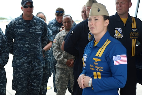 Marine Captain Katie Higgins gives her preflight brief to service members prior to letting them fly in Fat Albert, a C-130 Hercules, at the Southernmost Air Spectacular featuring the Navy and Marine Corps Blue Angels at Naval Air Station Key West Florida. Captain Higgins is the first female Blue Angels Pilot in history. (Photo by Sgt Michael Lopez, USMC)