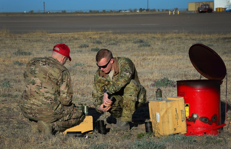 Team members with the 26th Special Tactics Squadron prepare a smoke signal system near a landing zone March 25, 2016, at Cannon Air Force Base, N.M. The smoke was used to help other 26th STS members performing routine practice jumps over the Cannon flightline. (U.S. Air Force photo/Staff Sgt. Alexx Pons)
