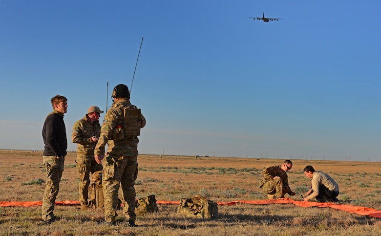 A ground team crew with the 26th Special Tactics Squadron prepares a landing zone March 25, 2016, at Cannon Air Force Base, N.M. Ground members established a safe area for other 26th STS members who would be performing routine practice jumps over the Cannon flightline shortly after the area was secure. (U.S. Air Force photo/Staff Sgt. Alexx Pons)