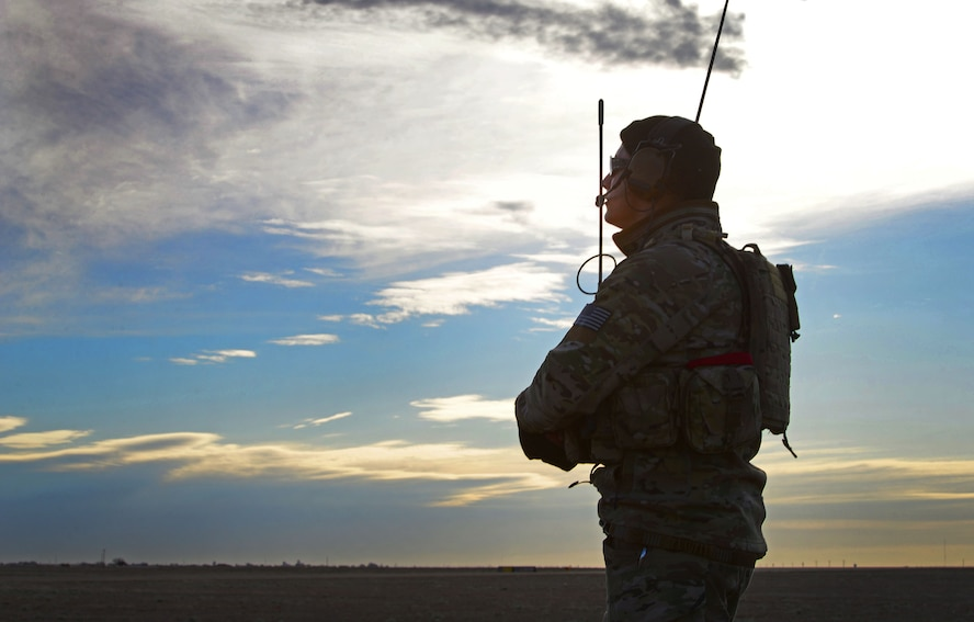 A member of the 26th Special Tactics Squadron monitors weather patterns and maintains communication with Air Commandos flying overhead March 25, 2016, at Cannon Air Force Base, N.M. Dozens of 26th STS members performed routine practice jumps over the Cannon flightline, and relied on ground crews to ensure exercise safety and success. (U.S. Air Force photo/Staff Sgt. Alexx Pons)
