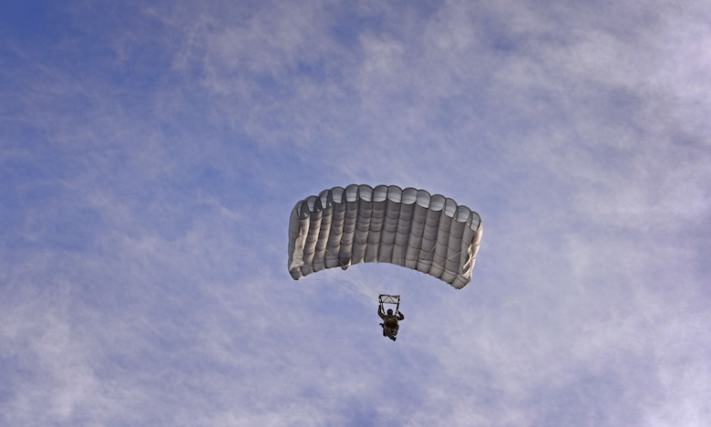 A member of the 26th Special Tactics Squadron parachutes down over the flightline March 25, 2016, at Cannon Air Force Base, N.M. Air Commandos with the 26th STS performed routine practice jumps as part of maintaining operational readiness. (U.S. Air Force photo/Staff Sgt. Alexx Pons)