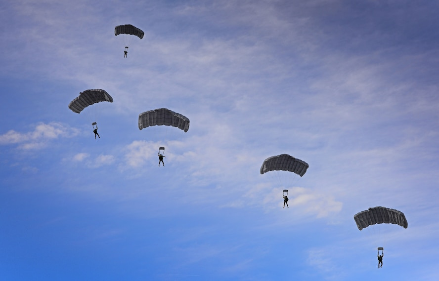Members with the 26th Special Tactics Squadron begin their decent over the flightline March 25, 2016, at Cannon Air Force Base, N.M. Air Commandos with the 26th STS performed routine practice jumps as part of maintaining operational readiness. (U.S. Air Force photo/Staff Sgt. Alexx Pons)