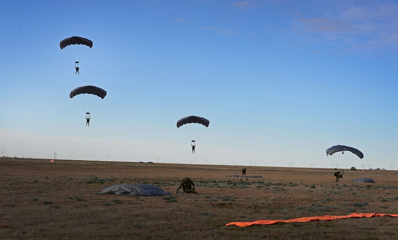 Members with the 26th Special Tactics Squadron make their final decent onto a landing zone March 25, 2016, at Cannon Air Force Base, N.M. Air Commandos with the 26th STS performed routine practice jumps as part of maintaining operational readiness. (U.S. Air Force photo/Staff Sgt. Alexx Pons)