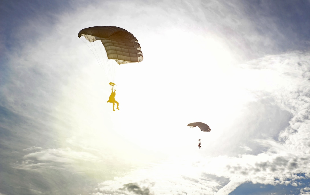26th Special Tactics Squadron members prepare for their final touch-down onto a landing zone March 25, 2016, at Cannon Air Force Base, N.M. Air Commandos with the 26th STS performed routine practice jumps as part of maintaining operational readiness. (U.S. Air Force photo/Staff Sgt. Alexx Pons)