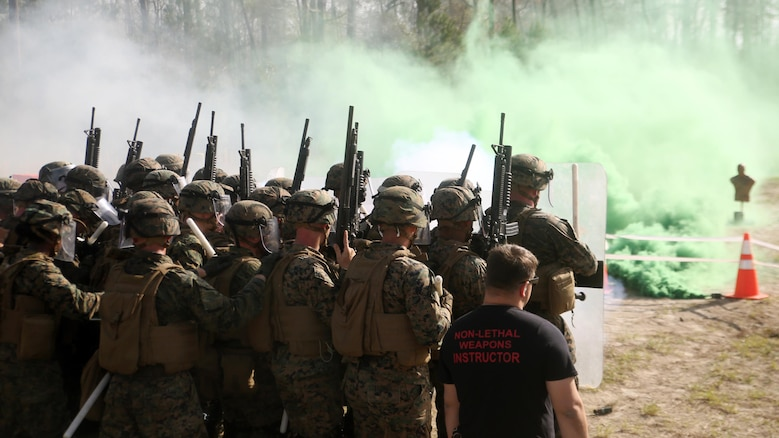 Marines with Combat Logistics Battalion 2 walk down a non-lethal weapons training range during the unit's non-lethal weapons training final exercise at Marine Corps Base Camp Lejeune, North Carolina, March 25, 2016. The battalion had to qualify through the Expeditionary Operations Training Group in preparation for their upcoming deployment with Special Purpose Marine Air-Ground Task Force-Crisis Response-Africa.